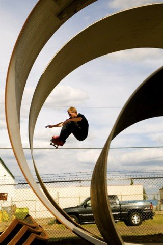 Chris Kendall performs an ollie while skateboarding
