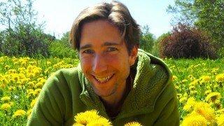 Jesse Bogdanovich in a dandelion field