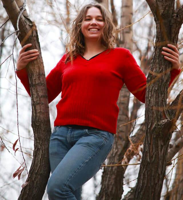 Victoria Everett posing in a tree