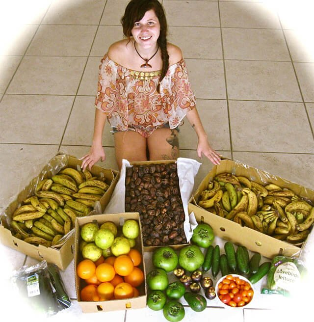 Tarah Millen photographed with several boxes of fruit