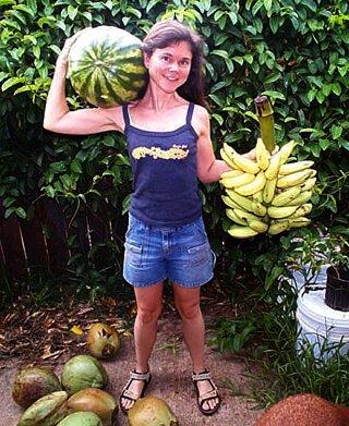 Janie Gardener holds watermelon and bananas