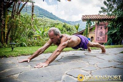 Dr. Doug Graham performs Superman pushups outside