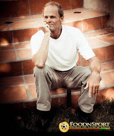 Dr. Doug Graham sits on steps with his hand on his chin
