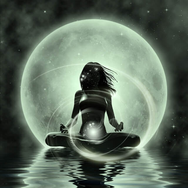 Woman practices moonlight yoga on the water