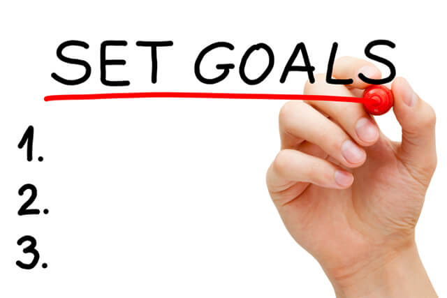 Woman writes her goals with a marker