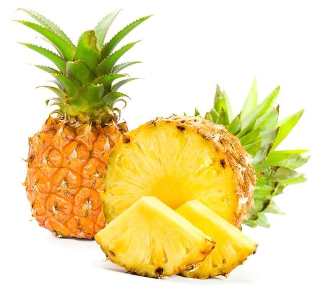 Sliced pineapple against white background