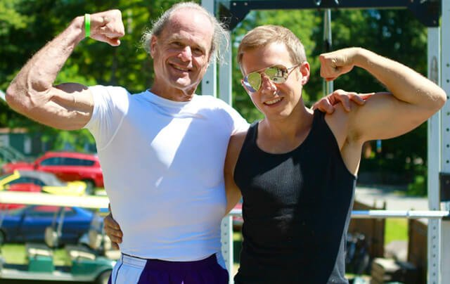 Mike Vlasaty flexes muscles with Dr. Doug Graham at the 2013 Woodstock Fruit Festival