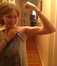 Miliany Bonet flexes a bicep