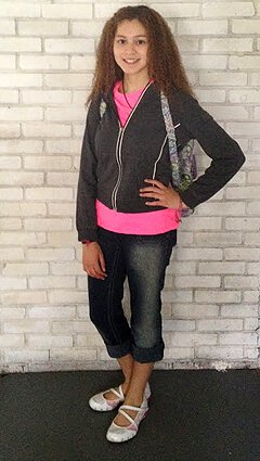 Miliany Bonet stands with a hand on her waist