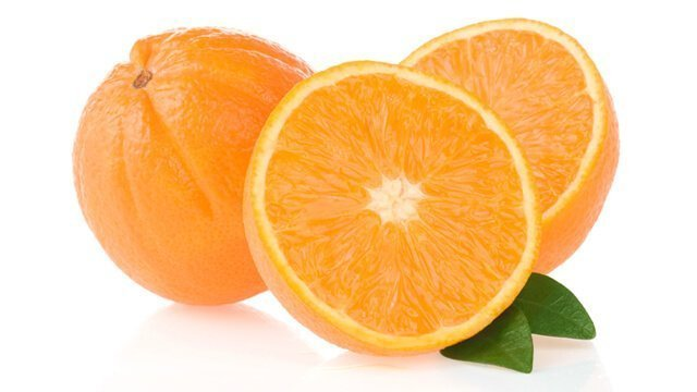 Whole and halved oranges against white background