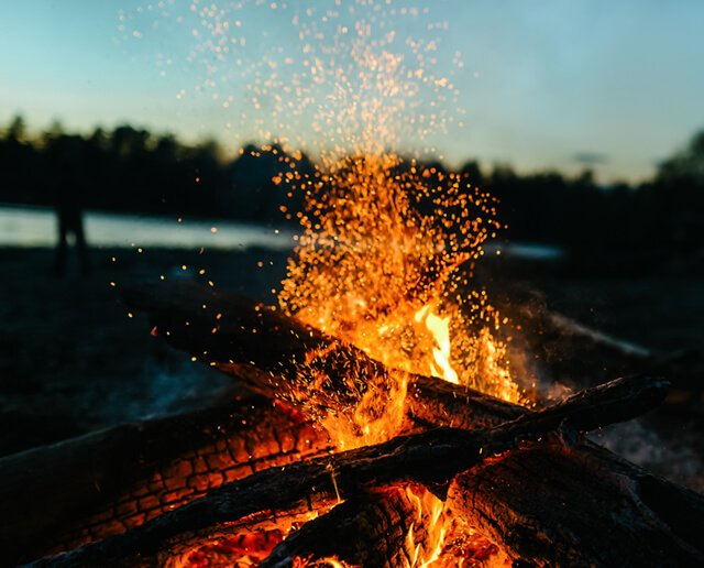 A bonfire roars in the evening