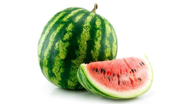 A whole watermelon and a large slice