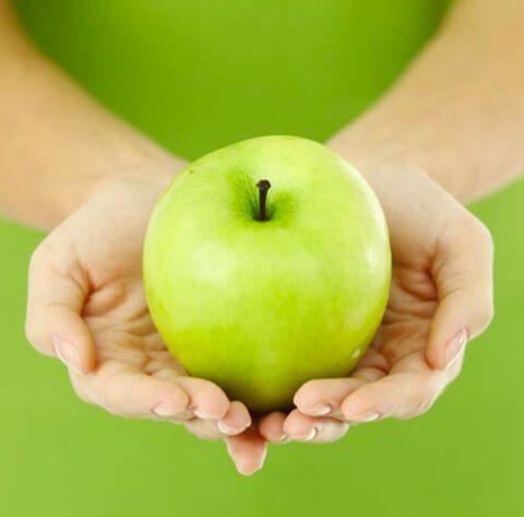 Granny Smith apple being held