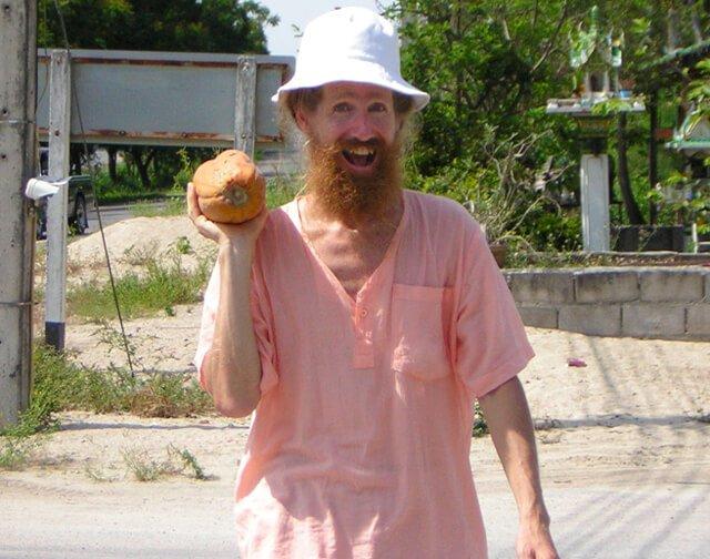 Jimmy Gilker raises a papaya with glee.