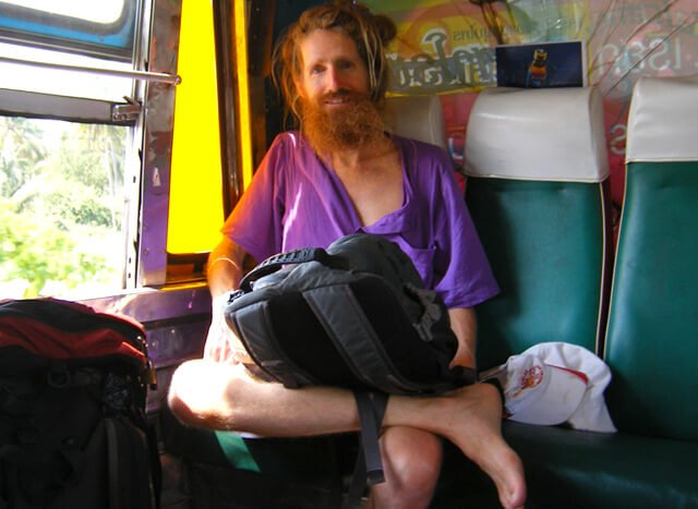 Jimmy Gilker smiles while sitting on a bus in Thailand