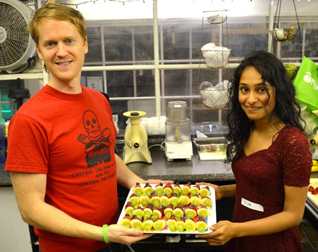 Silpa Reddy and Tim Radley hold Tim's meal contribution at the December 2013 potluck at Arnold's Way