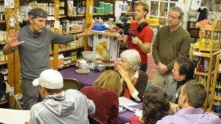 Arnold Kauffman talks to guests at the December 2013 potluck at Arnold's Way