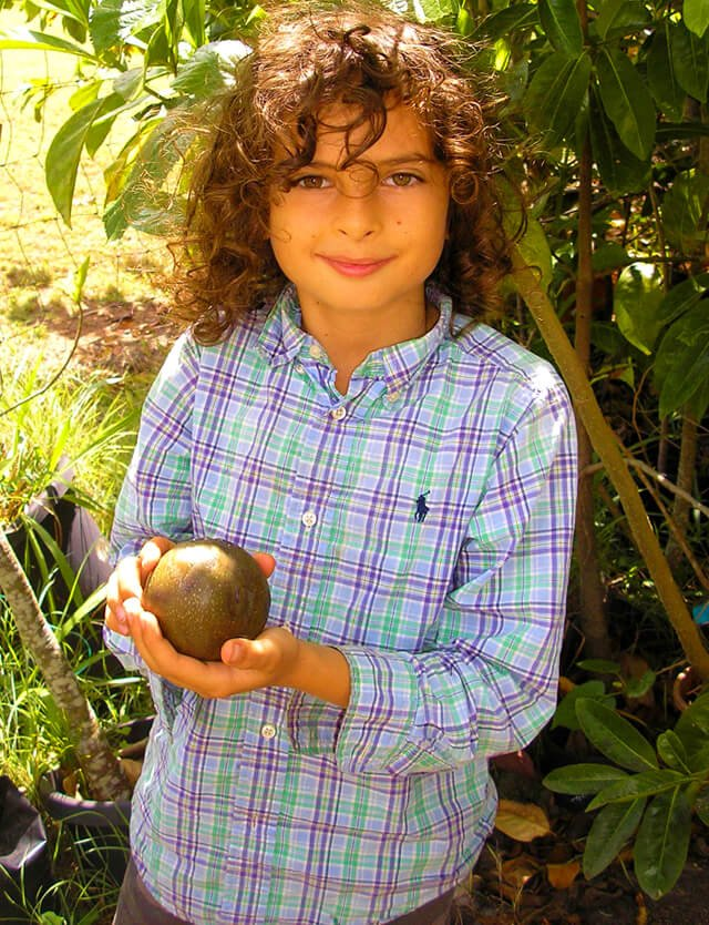 Cappi Osborne is photographed holding fruit