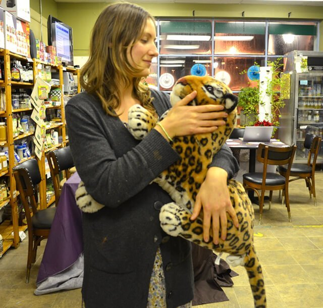 Julie Kersey playfully holds a stuffed tiger at Arnold's Way in Lansdale, Pennsylvania