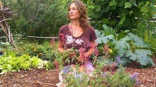 Julie Kersey sitting on her knees in a garden