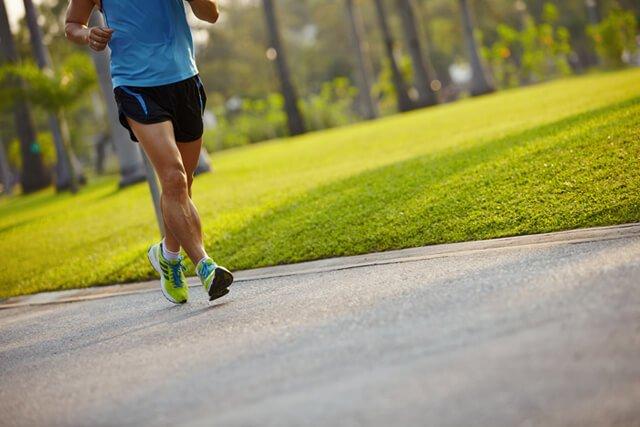 Man running along a blacktop path