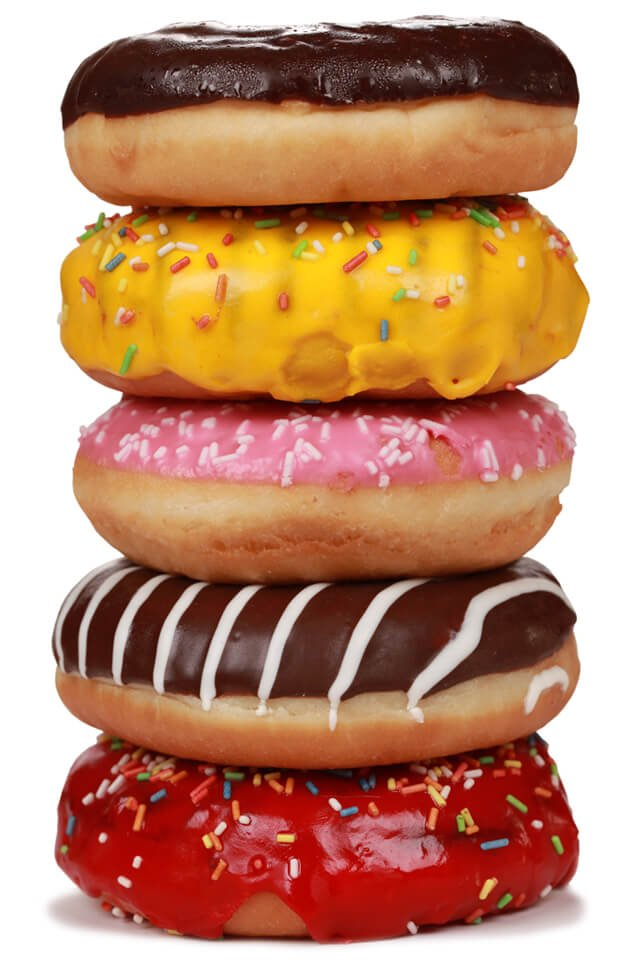 A stack of five doughnuts against a white background