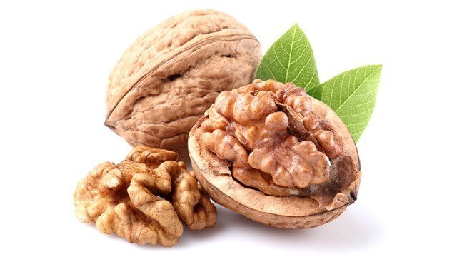 Dried walnuts against a white background