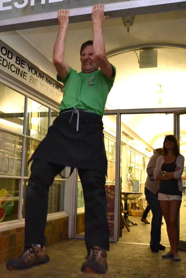 Arnold Kauffman practicing chin-ups outside Arnold's Way