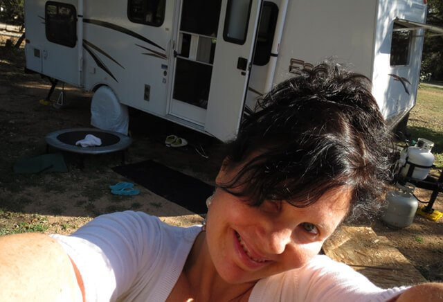 Joy King is photographed standing in front of her RV