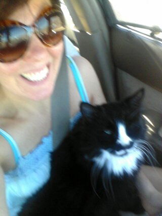 Joy King in her RV with her cat, Harley, on her lap