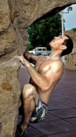 Korey Constable calculates his next move while rock climbing