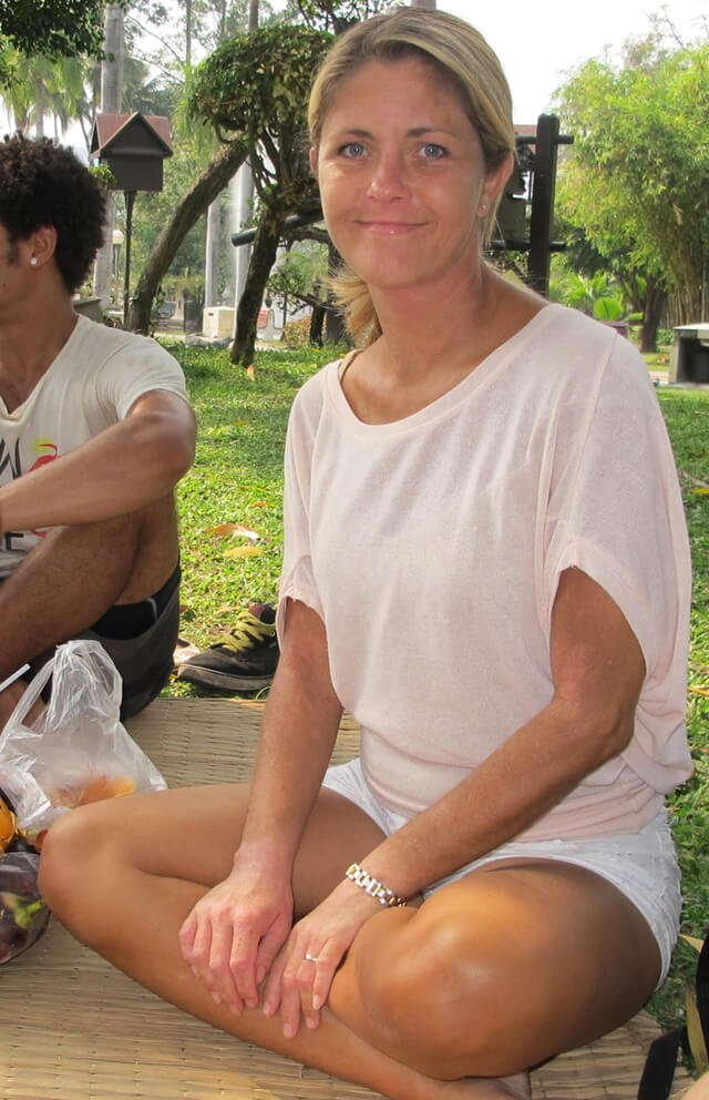 Louise Koch poses for a photograph in a Thailand park