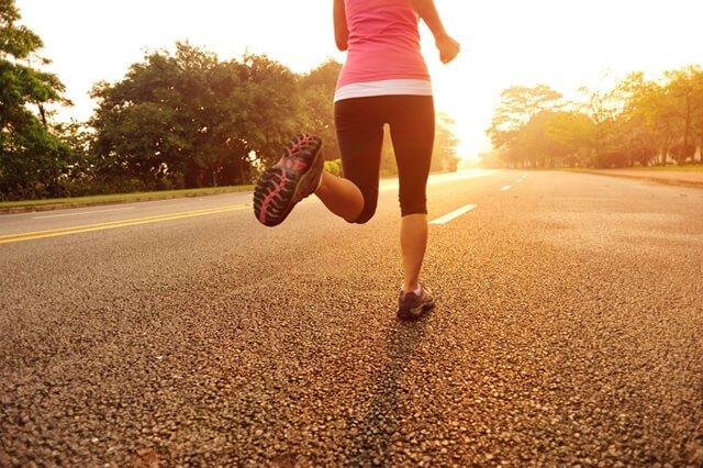 A woman runs in a street