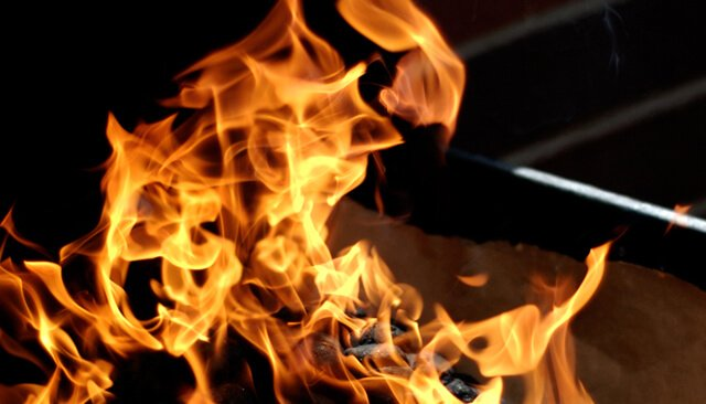 Roaring flame over a barbecue grill