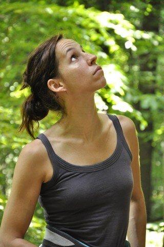 Deanna Husk looks up in a field