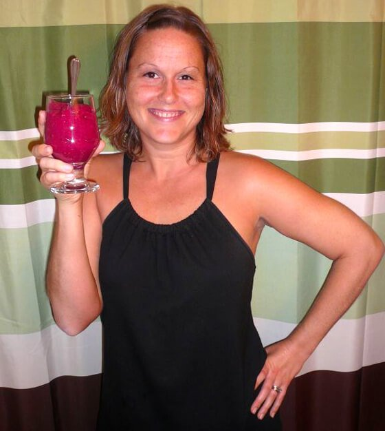 Tasha Lee holds a deep-red fruit meal in a glass
