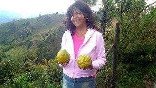 Toni-Allen-holding-two-tropical-fruits