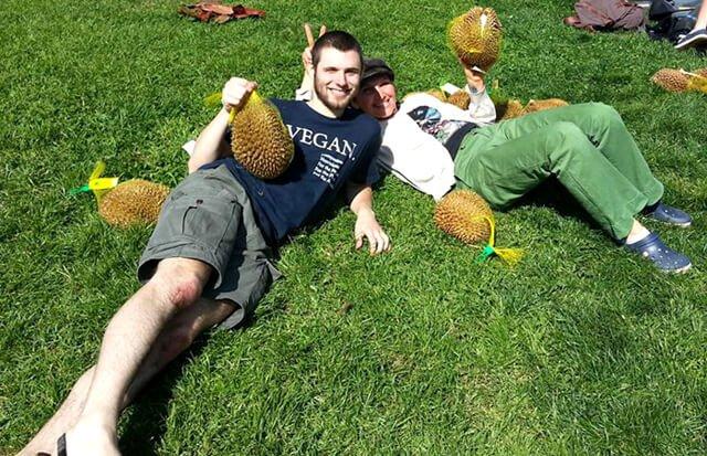 Benjamin Beeler holds durian at a fruitluck