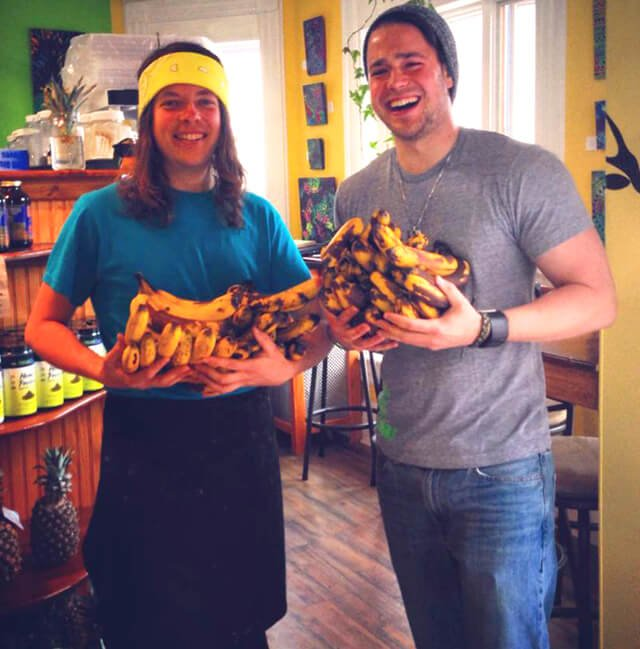 Dan McGrogan and a customer holding bananas after eating 30 each