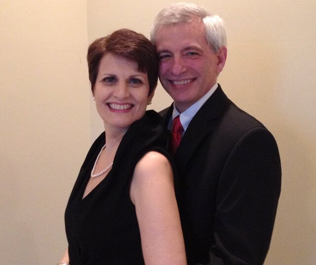 Irene Bojczuk smiles with Doug at a formal event