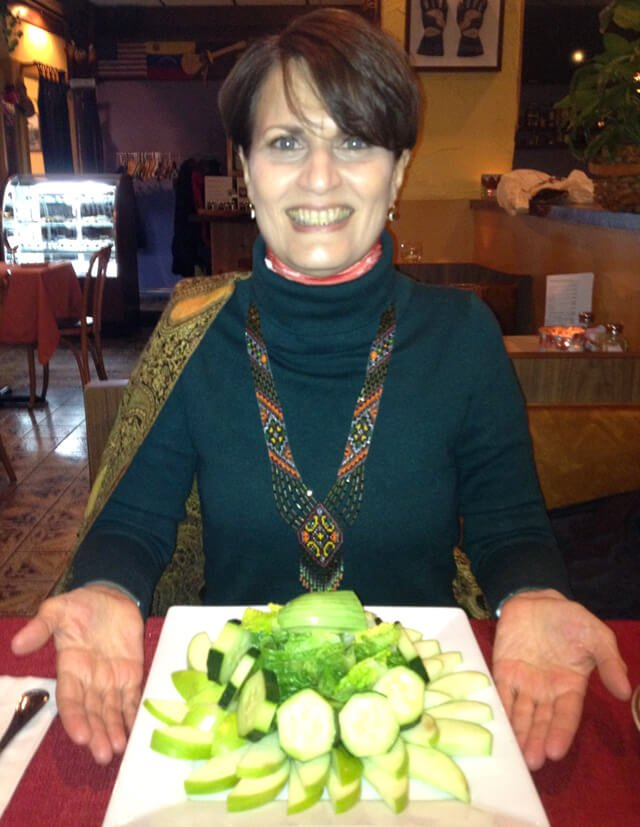 Irene Bojczuk is photographed presenting a fruit platter she ordered at a restaurant