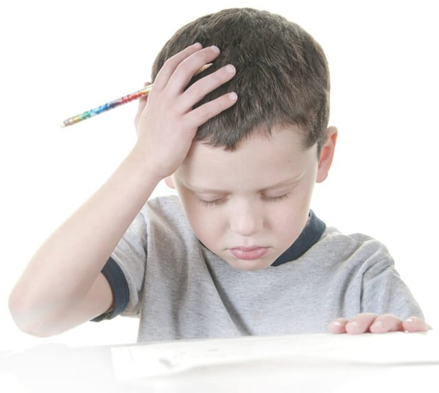 Boy stressed with school work