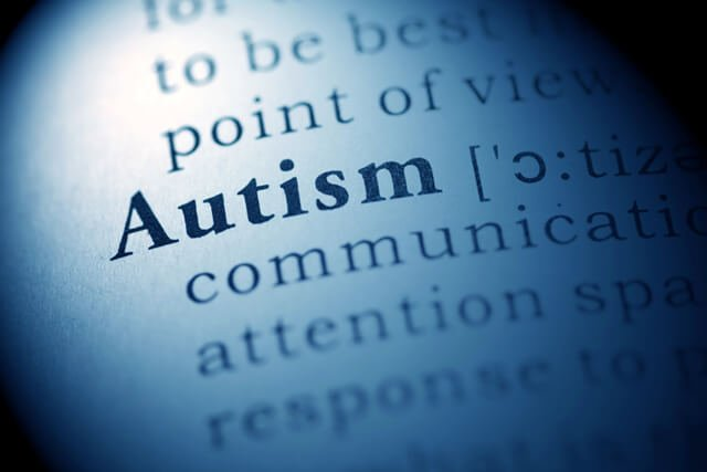 """The word """"autism"""" spotlighted in a dictionary"""
