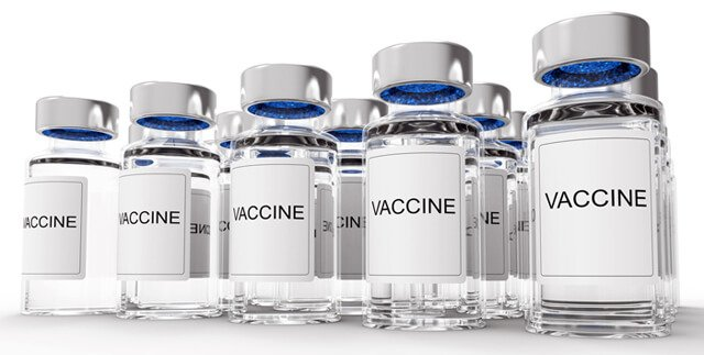 Vaccine bottles against a white background