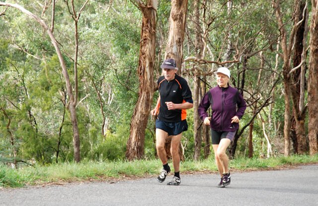 Janette Murray-Wakelin and Alan Murray running Pound Bend in Australia