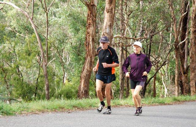 Janette Murray-Wakelin and Alan Murray running Pound Bend in Australia