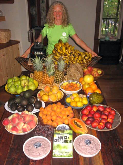 Janette Murray-Wakelin behind a mound of fruit and her book