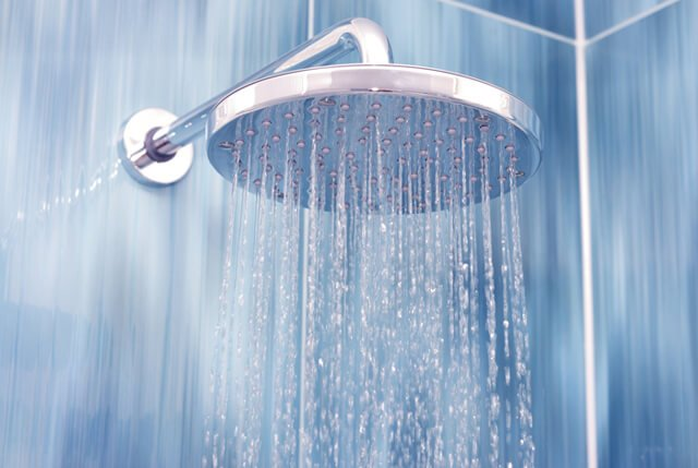 Water flowing from a showerhead