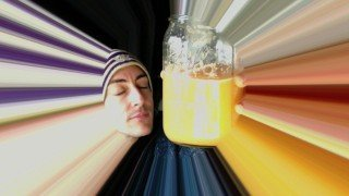 Victor VanRambutan holds an orange-colored smoothie in an effects photo