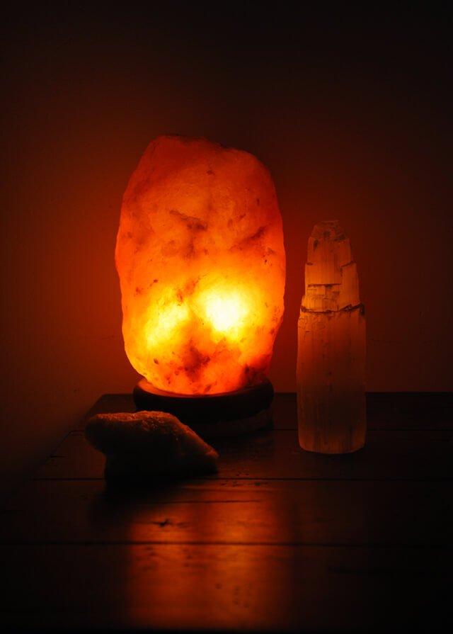 A Himalayan salt lamp lights up part of a room
